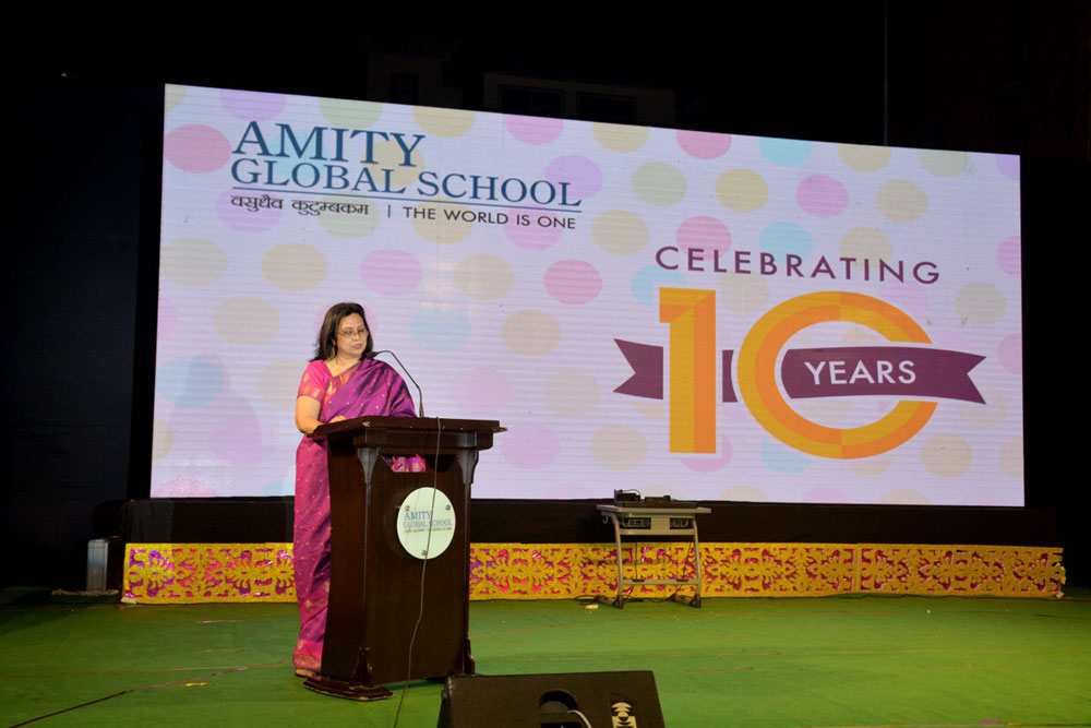 PRINCIPAL, Mrs Arti Gupta, proudly highlighting the achievements of AGS as Amity's first IB & CAIE school in it's 10th year