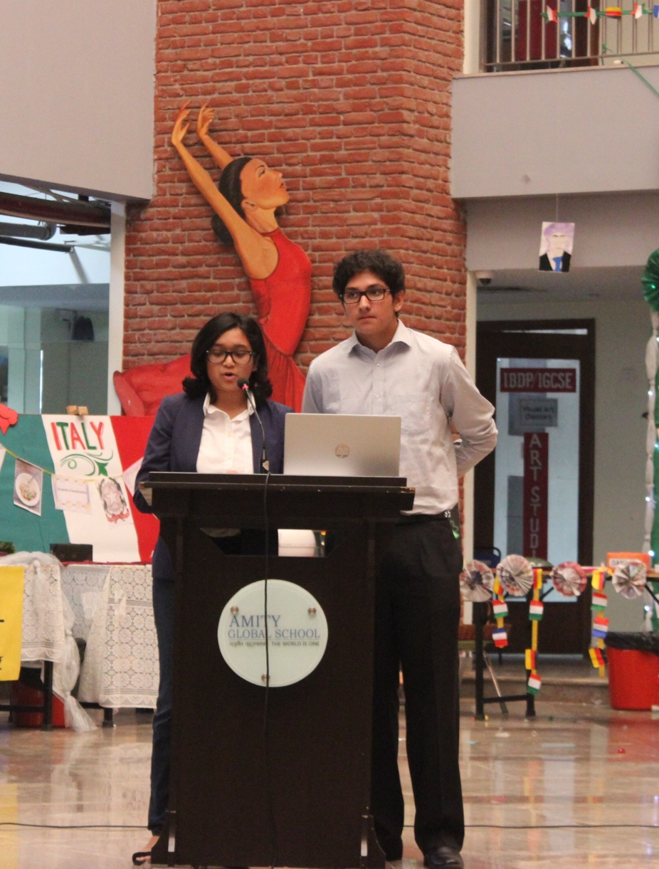 The emcees sharing the highlights of International Day