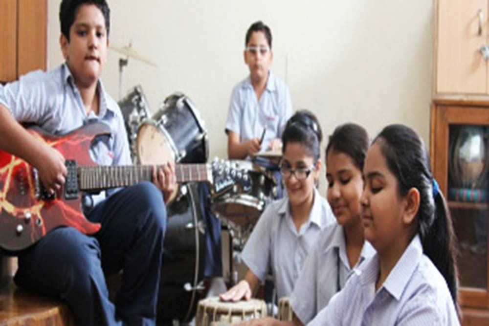 Students participating in art and music activities